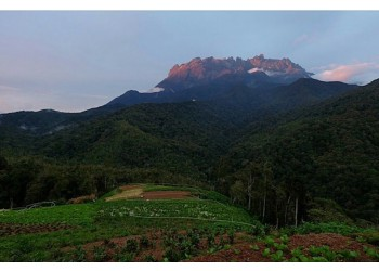 Sunlight Creeping Over The Jagged Peaks of Mt Kinabalu